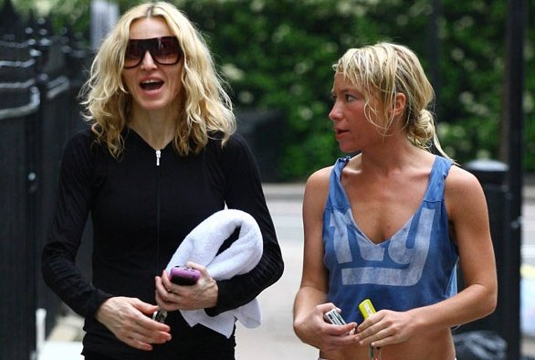Madonna walking alongside trainer Tracy Anderson