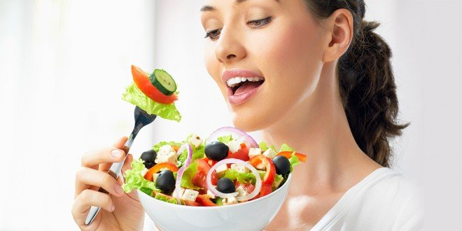 Woman eating Mediterranean salad