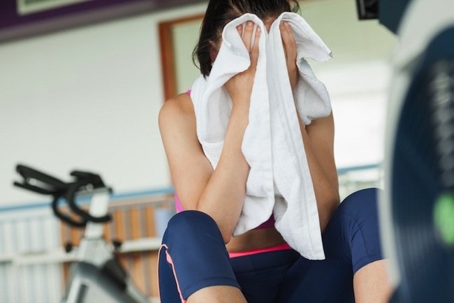 Woman drying sweat at gym